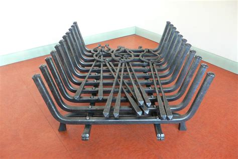 blacksmith custom designed fireplace grate and tongs