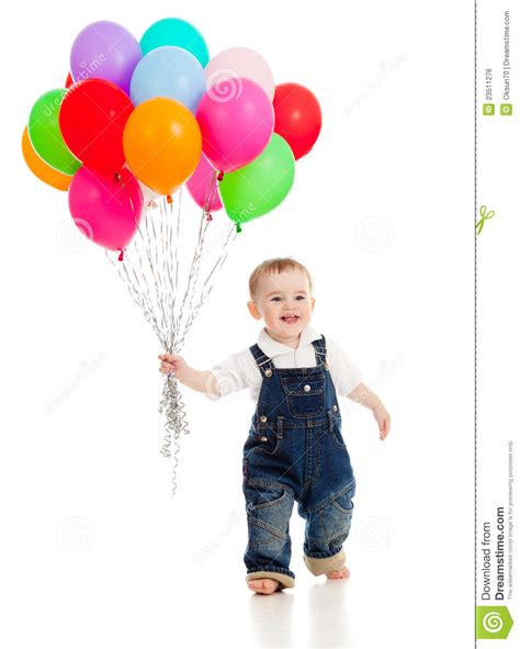 smiling baby boy with bunch of colorful balloons stock