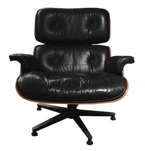 eames armchair and ottoman lounge chair and ottoman by charles eames at 1stdibs