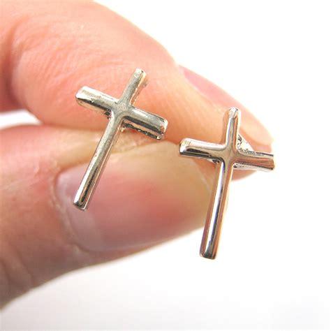 small simple cross shaped stud earrings in light gold