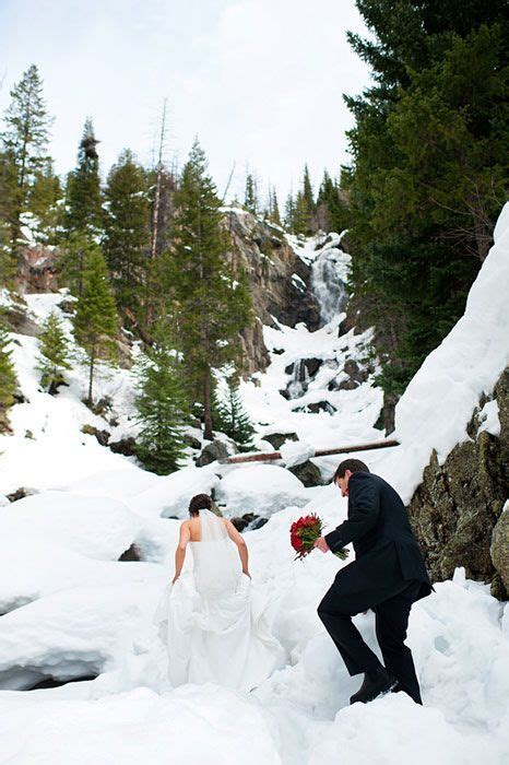 Wedding photographer at a snowy Fish Creek Falls in