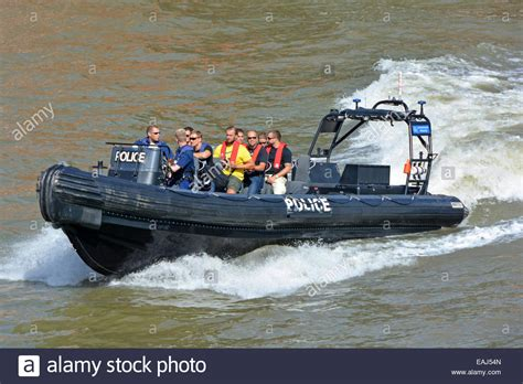 thames river speed boats metropolitan police inflatable speed boat on river thames