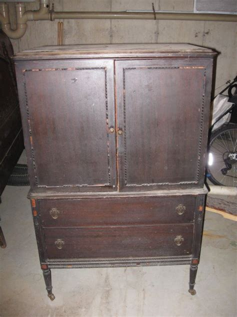 i an antique revell co armoire in poor condition