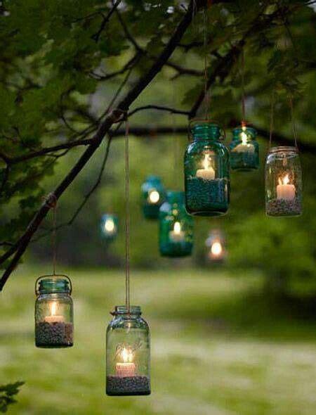 frascos  vela  iluminar  arbol de jardin luces