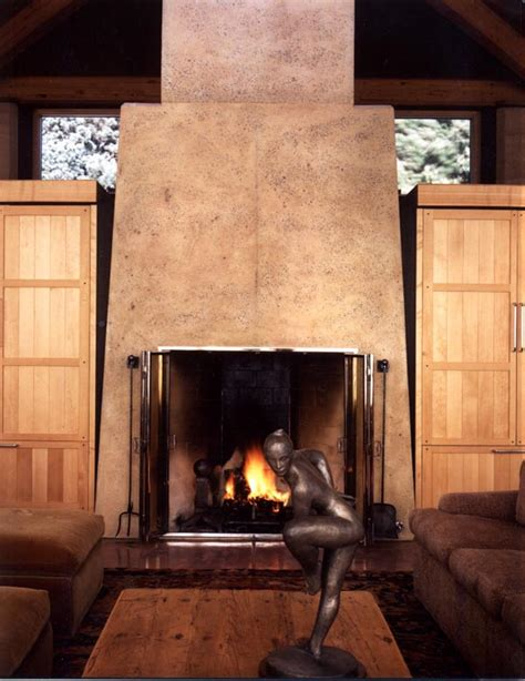 Back To Back Fireplace Design by Rumfords