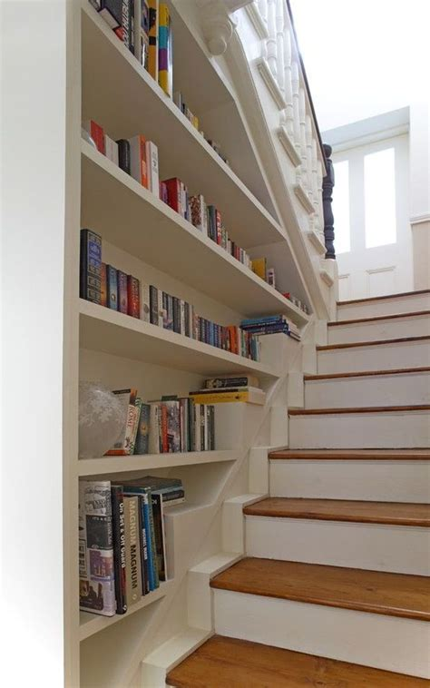 build bookshelves into wall bookcase built into stair wall entry way stairs shelves traditional and