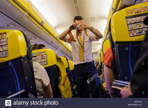 ryanair cabin crew ryanair cabin crew demonstrating safety procedures