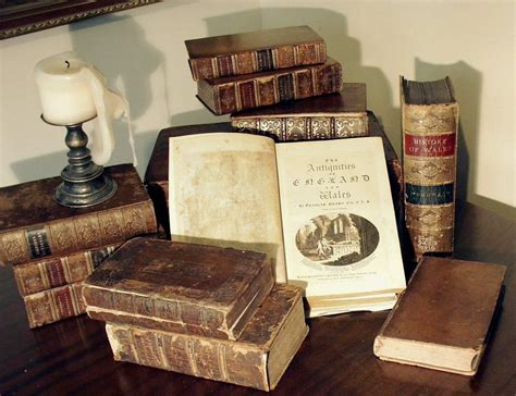 Antique Vintage file grose antique books with candle jpg