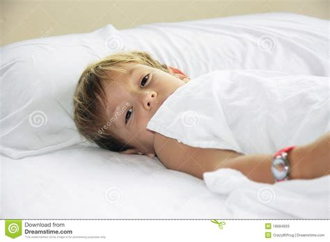 young boy in bed stock photos image 18684933