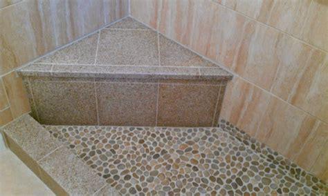 river rock bathroom tile shower pan river rock granite seat and curb