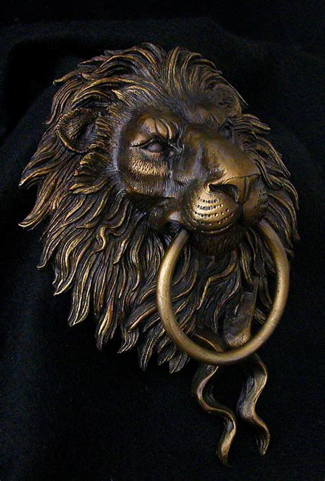 gold film craft lion lion head door knocker photograph by karl sanders