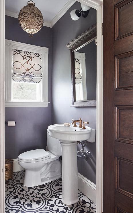 purple powder room with parisian pedestal sink