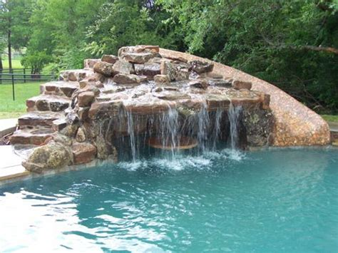 natural stone swimming pool waterfalls top ten grotto pacific pool grotto slide with custom stone table for