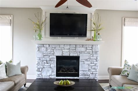 Where To Place Tv In Living Room With Fireplace by White Washed Stone Fireplace Life On Virginia Street