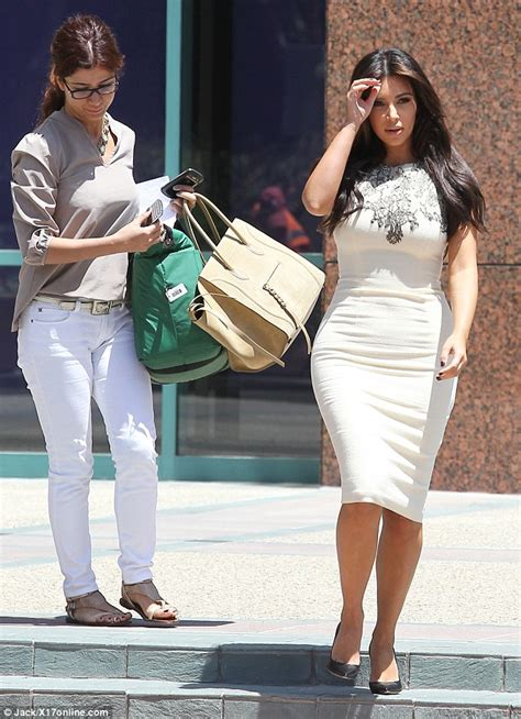 Kim Kardashian tones down her look for business meeting