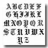 cursive letter t tattoo