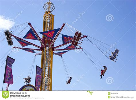 rotating swing swing carnival ride editorial stock image image of