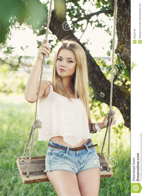 girl swings beautiful girl on a swing stock photo image 44553749
