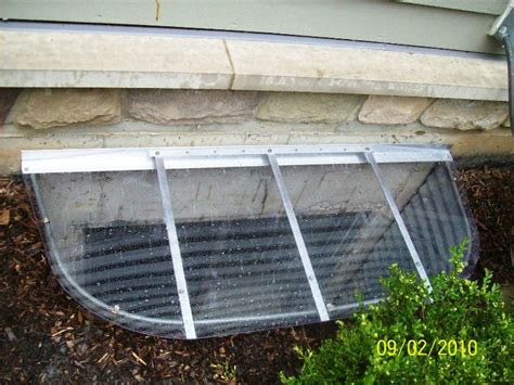 clear window well covers 64 quot x 38 quot sloped window well cover with 11 quot radius