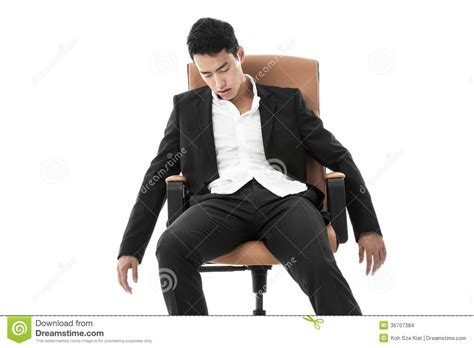 businessman sleeping on a chair stock images image 36707384