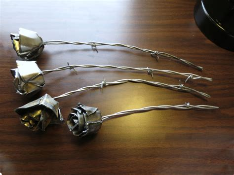 Custom Roses Crafted From Welding Steel And Barbed Wire