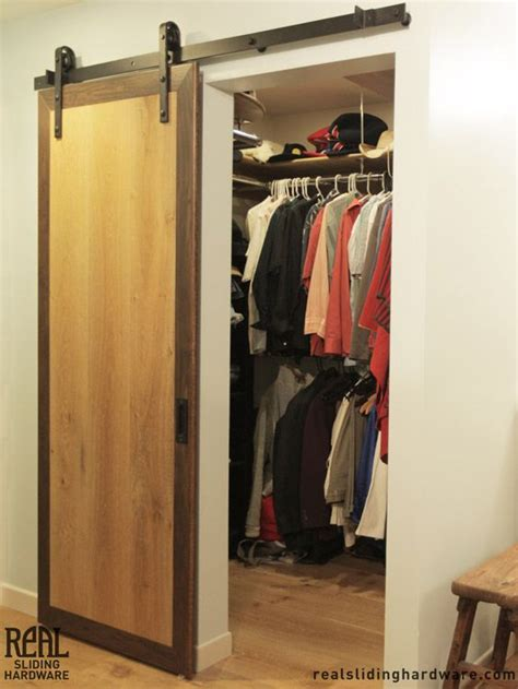 Closet Utilizing Hammered Flat Track Sliding Barn Door Barn Door Closets