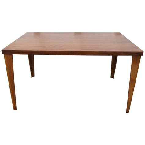 charles eames dining table dtw 1 dining table in walnut by charles eames for