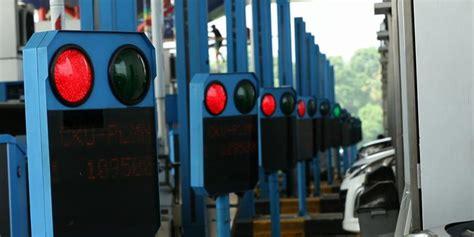Tongkat Kartu Jalan Tol Elektronik Panjang hindari antrean panjang siapkan kartu pembayaran elektronik kompas