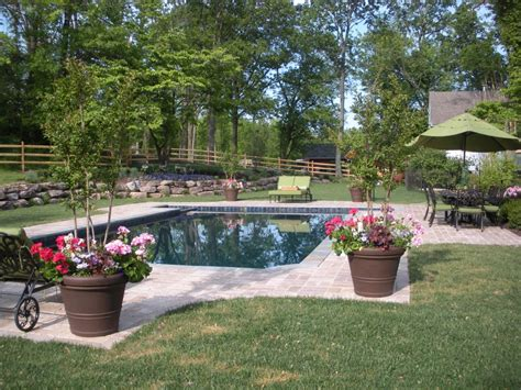 Backyard Pool And Patio Stunning Patio Designs With Comfort Patio Design With Swimming Pool With Green Grass Grezu