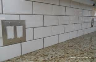 white subway tile kitchen backsplash brown kitchen cabinets with white subway tile quicua