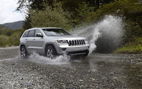 small jeep cherokee 2011 jeep grand cherokee crossing through a small river