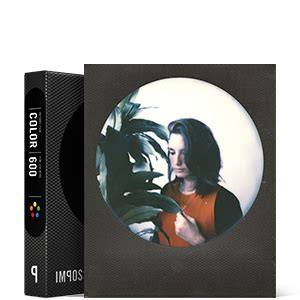impossible instant color film with round black frames for