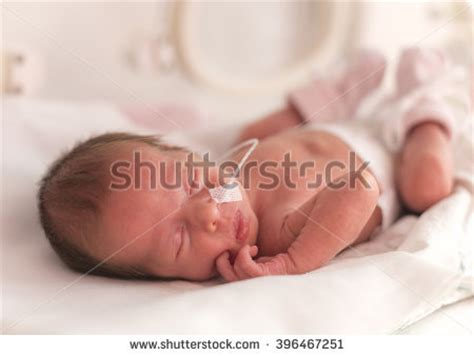newborn baby after c section royalty free premature newborn baby girl in the