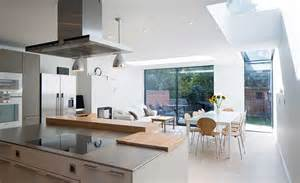 the latest kitchen layout ideas real homes stainless steel extractor hood above large island unit in