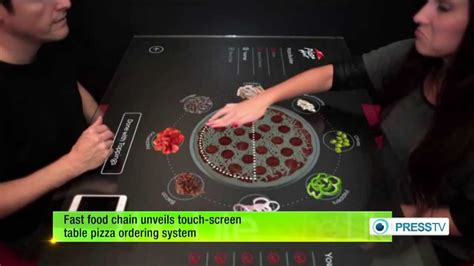 fast food chain unveils touch screen table pizza ordering