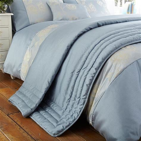 Blue Quilted Throws For Beds by Antonia Faux Silk Jacquard Quilted Bed Throw Powder Blue