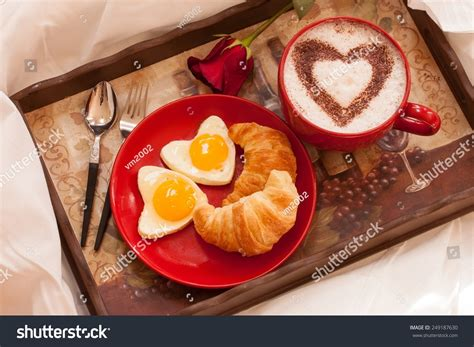 in bed with breakfast in bed eggs and croissants with a cup of coffee stock photo 249187630