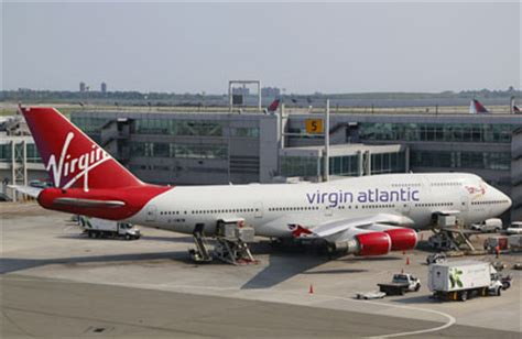 virgin atlantic plane with landing gear fault lands safely
