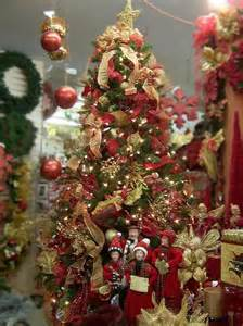Christmas tree is decorated with vintage ornaments in gold and red