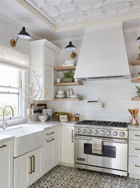 metro cabinet and flooring all white kitchen with brass hardware and gray and white