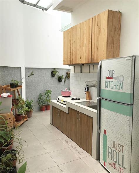 desain dapur terbuka ke taman rumah riche desain hunian istimewa dengan ruang makan terbuka
