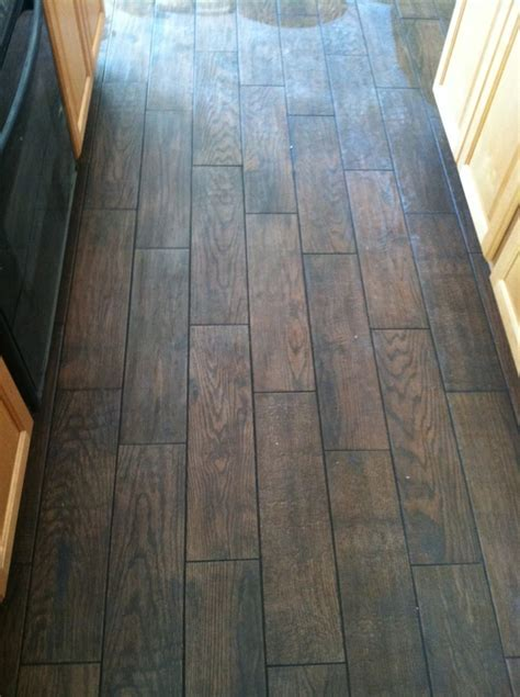 porcelain wood look plank tiles from marazzi in the color quot saddle quot with charcoal grout yelp