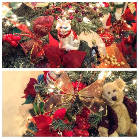 Christmas tree decorated with berries poinsettias ribbon a teddy