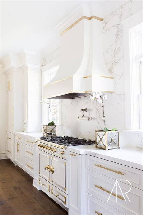 white and gold kitchen features white cabinets adorned kitchen with gold trim design ideas