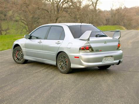 mitsubishi evolution 2006 us mr badge vs uk mr badge evolutionm mitsubishi