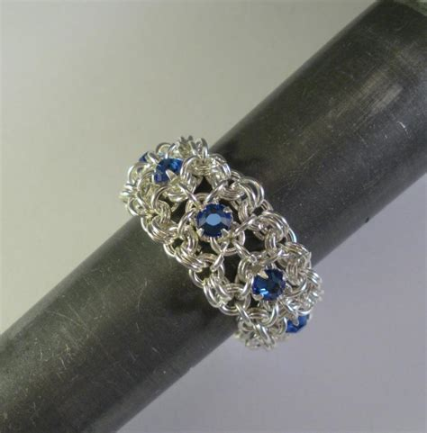 chain maille ribbon eternity ring in sapphire blue