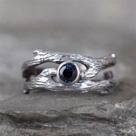 blue sapphire twig style engagement ring and wedding band