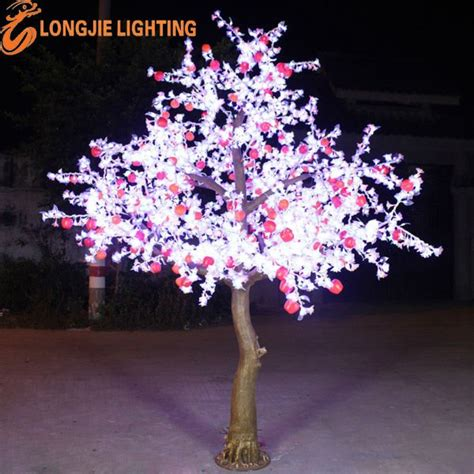 white outdoor lighted christmas trees