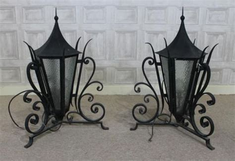 WROUGHT IRON LANTERNS, A PAIR OF ORNATE OUTDOOR LIGHTS