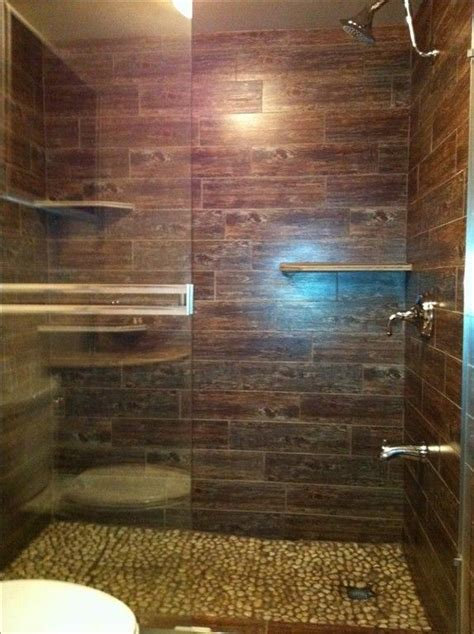 wood looking tile in bathroom 24 best images about wood tile showers on